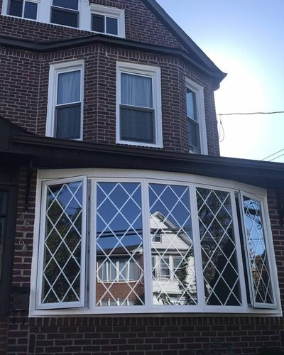 Flushing bow window replacement