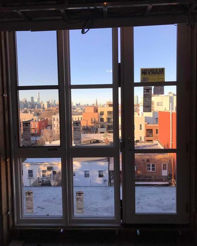 Queens commercial building new Marvin window